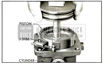 1953 Buick Installing Steering Gear Piston With Ring Compressor