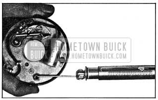 1954 Buick Checking Tension of Base Plate