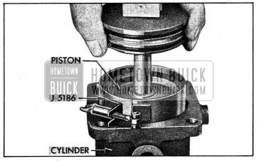 1954 Buick Installing Piston With Ring Compressor View